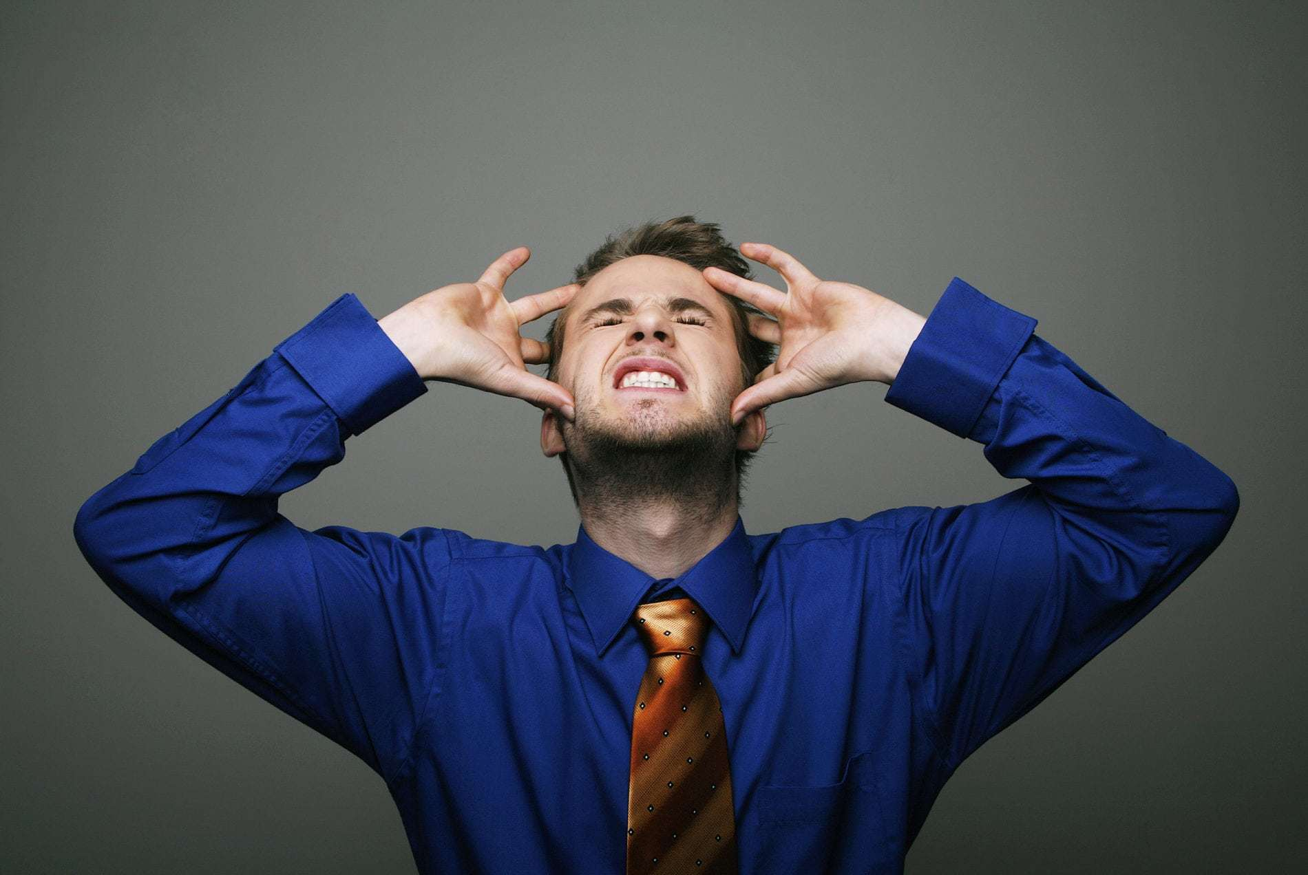 stressed man - 4 Ways I.T. Support Companies Drive Us Crazy