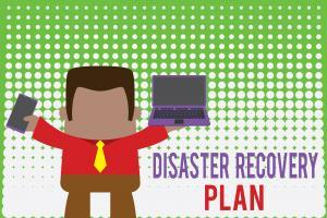 Writing note showing Disaster Recovery Plan. Business photo showcasing having backup measures against dangerous situation Professional man holding laptop in left mobile phone right.